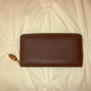 Black Gucci wallet with bamboo zipper handle